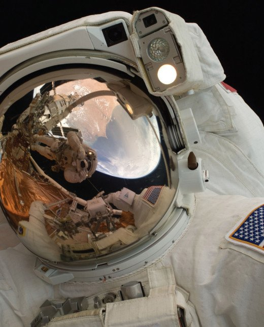 A close-up of spacewalking American astronaut John Grunsfeld