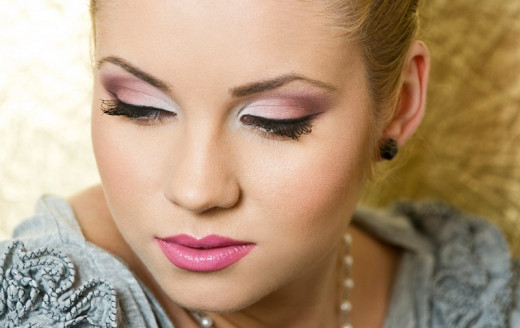 Shades of pink on lips and eyes