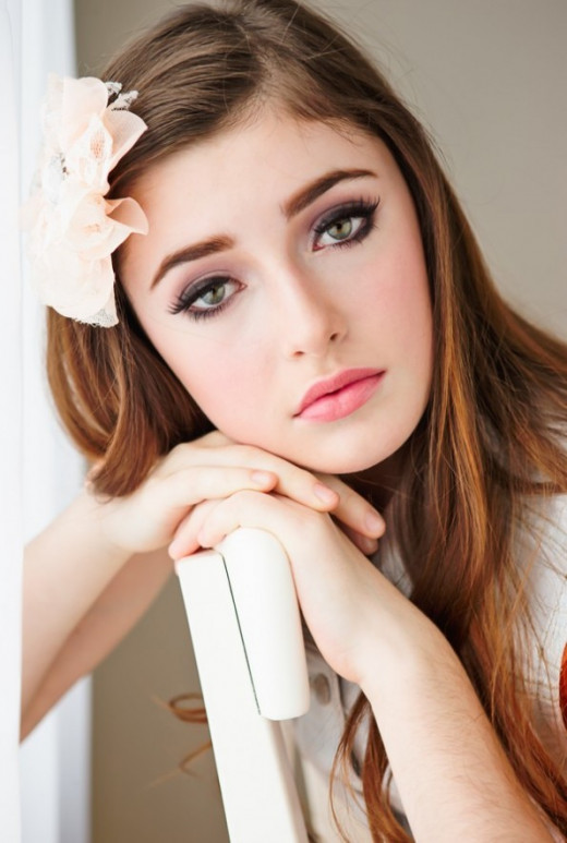 Light pink lips and smoky eyeshadow create this soft look