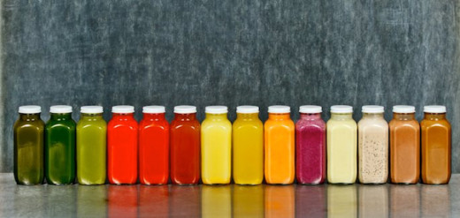 "A ""Rainbow"" of Cold Press Juice Bottles"
