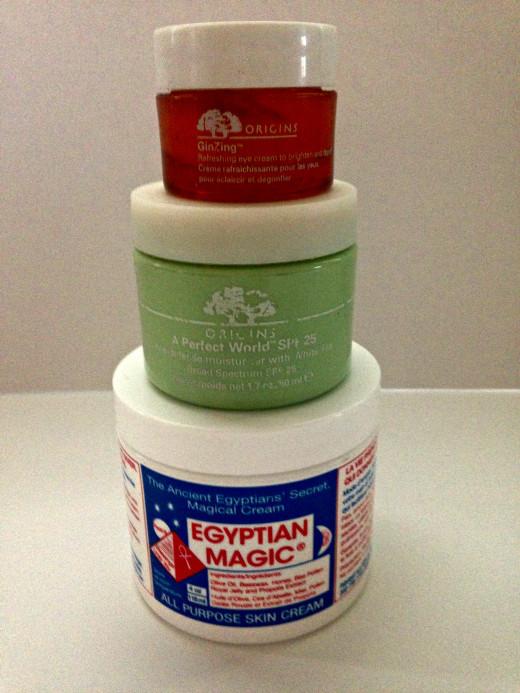 Egyptian Magic All Purpose Skin Cream, Origins A Perfect World SPF 25 Age Defense Moisturizer, and Origins GinZing Refreshing Eye Cream