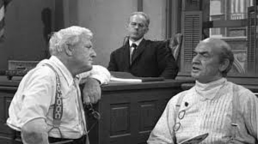 "This is a scene from a Spencer Tracy (shown standing) movie called ""Inherit The WInd"" (1960) which was based the Tenessee V. John Scopes Trial about teaching evolution in public schools."