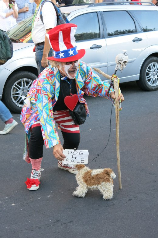 This man appears to have donned a costume and is having fun with his toy dog.