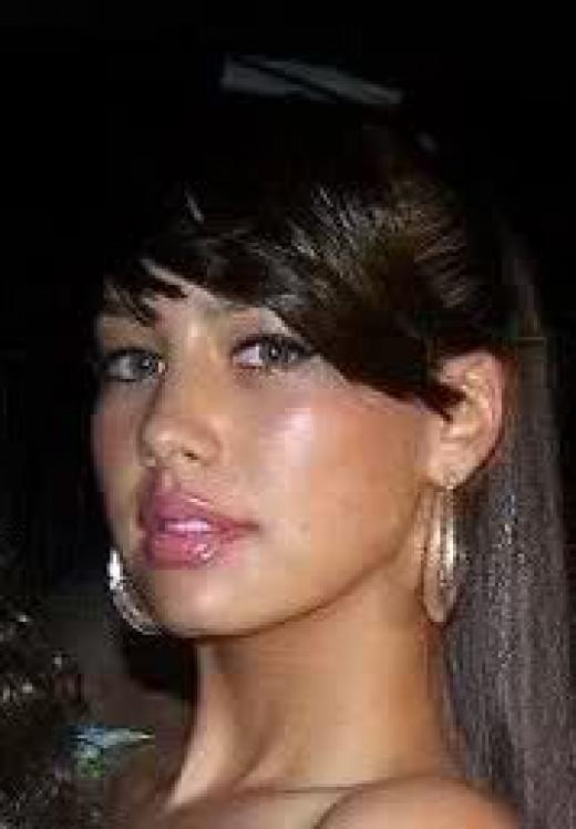 Amber Rose with long hair and bangs, dark brown