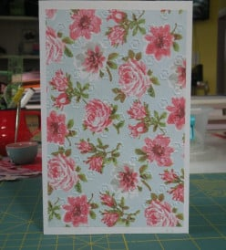 Embossed patterned cardstock adhered to base card