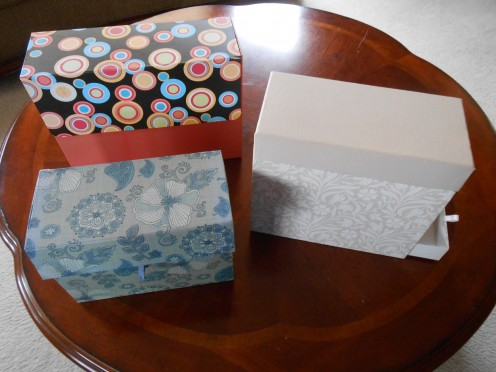 Greeting card organizers that I got for free, or close to it, when purchasing greeting cards!  I love them.  A great way to keep my cards in one place and safe from spills or bending, etc. The one on the right has a little drawer for pens or postage.