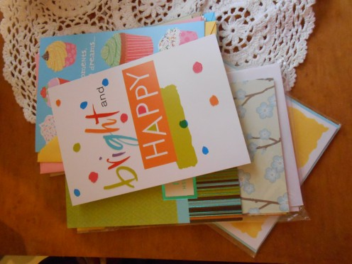 Keep the right envelopes with the right cards, avoid bending what you spent money on, or time making, etc.