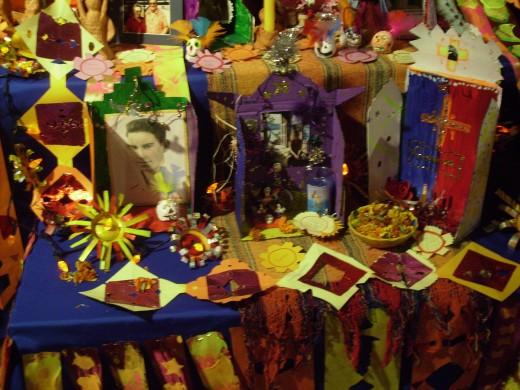 Close up of some of the items included in an altar created by students memorializing deceased ancestors.