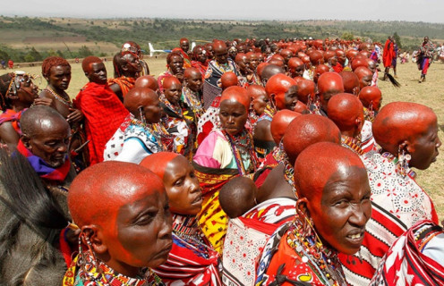 Kenya's Maasai women in a traditional ceremony with red ochre symbolizing beauty and maturity
