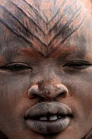 Turkana woman with decorations on her face depicting beauty in terms of culture