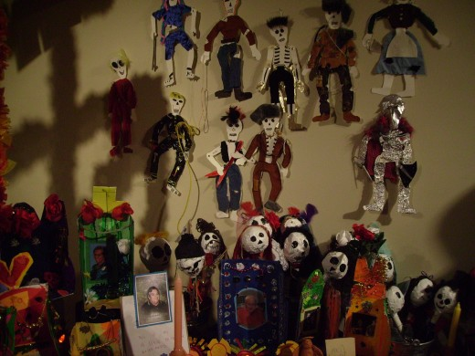 Wall decorations behind the Dia de los Muertos altar.