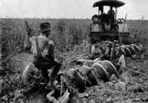 Vintage tilling the land