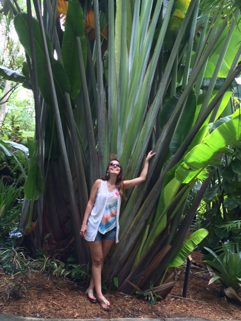 Me soaking up the energy of a Traveling Palm Tree in a 100-year-old Tropical Garden.