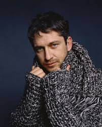 Gerard Butler clutching his special sweater
