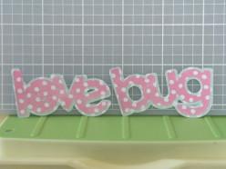 Love Bug phrase adhered