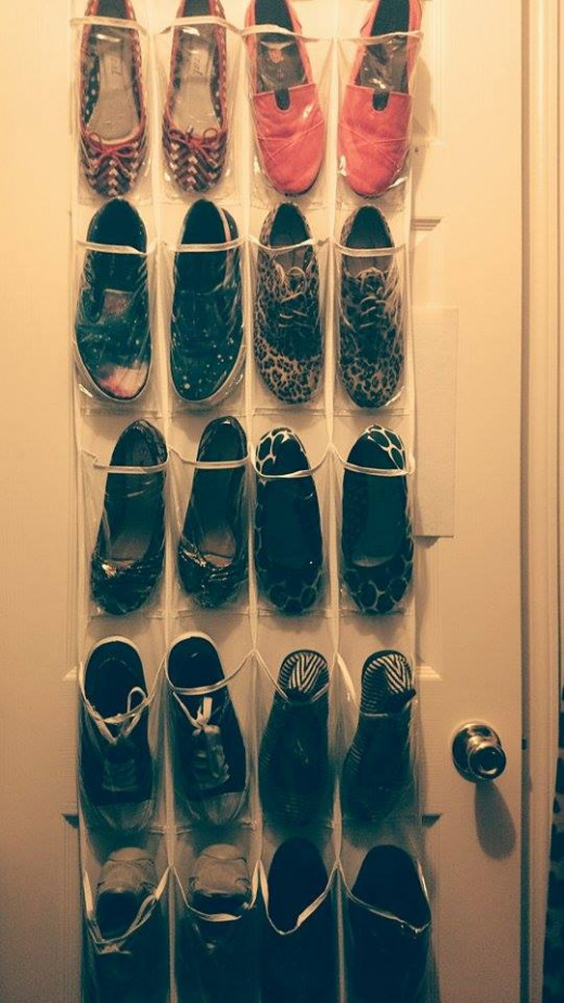An over the door organizer takes up virtually no space from your closet but maximizes your vertical space. Win!