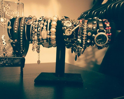 A bracelet holder can be found at many organizing or home stores for next to nothing. You can also make your own.