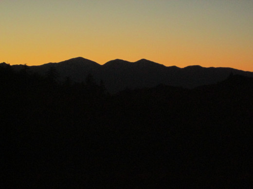 The orange sky above the silhouette of Mount Baldy.