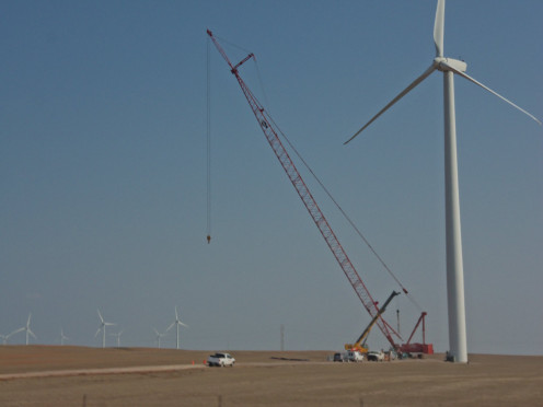 In this photograph they are just finishing up on the erection and construction of a windmill.