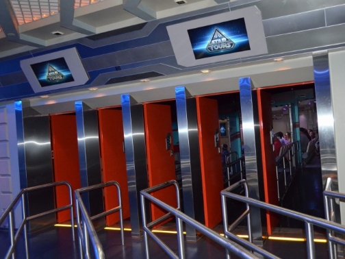 Notice the guests seated inside, prepared for the 3D simulation ride STAR TOURS at Disney's Hollywood Studios. The moving seats simulates a ship piloted by C3PO rocketing through various obstacles including dodging blasts in an epic space battle.