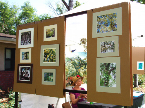 My photographic display of local trees flanking one of our table staffers.