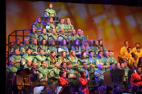 The mass choir arranged in a Christmas tree design during the Candlelight Processional at Walt Disney World's EPCOT during the holidays.