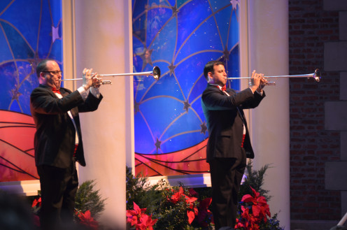 Trumpets herald a birth during the Candlelight Processional performance at Walt Disney World's EPCOT during the holidays.