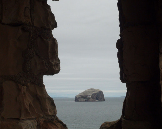 This Photo View of Bass Rock from Inside the Castle through an Archer's Slot window ruin.
