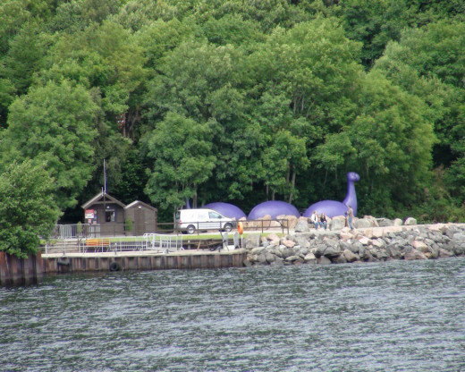 This is one of two fake Loch Ness Monster art designs used to amuse the tourists.  We were not told why the Nessie is purple in color, nor did we ask.  It is located next to the Boat Tour dock where they collected our tickets in the brown building.
