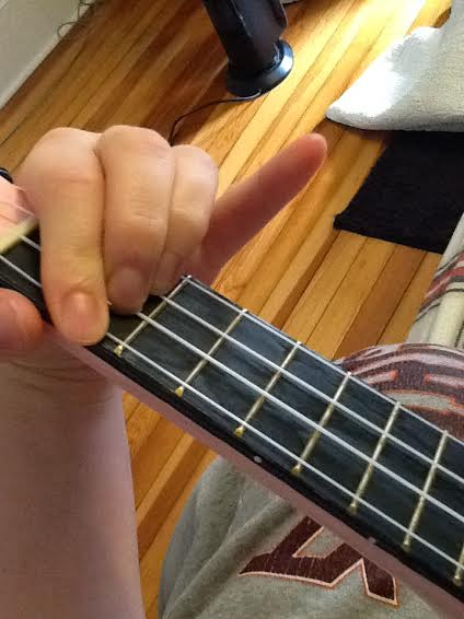 Do chord. See how every string on the second fret is closed but the A string?