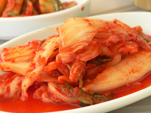 Often described as spicy and sour, Kimchi, a traditional lacto-fermented Korean  dish, is made of vegetables with a variety of seasonings.