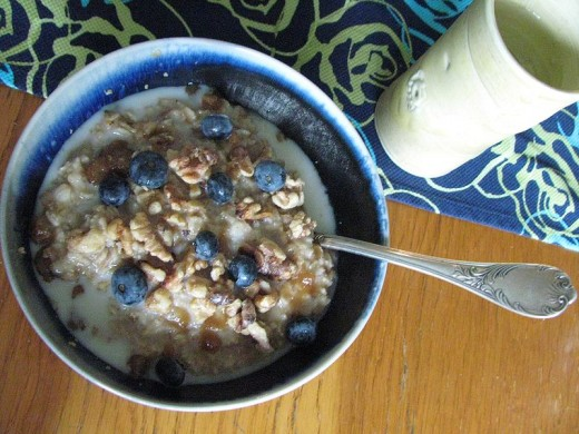 Oatmeal with blueberries, honey, and almond milk.