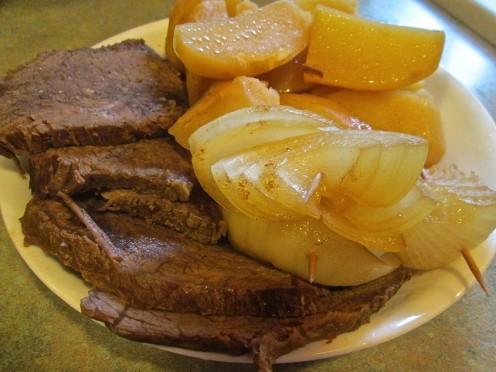Crock Rump Roast Beef and onions and potatoes.