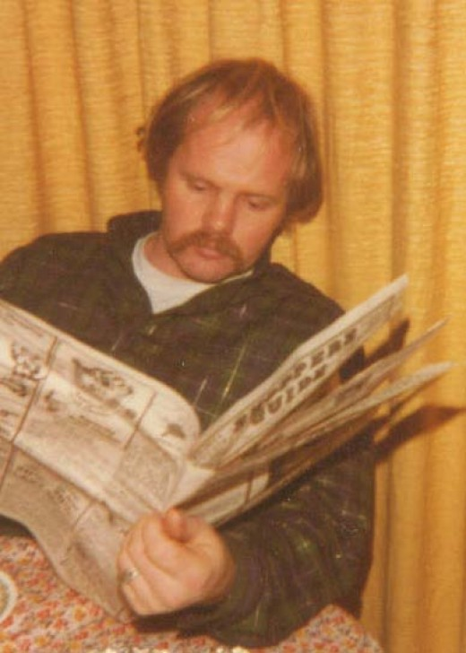 Owen reading the newspaper.