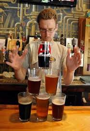 A variety of beers will be served and celebrated during Asheville's first Beer Week. Pictured is Justin Smith at Asheville Pizza and Brewing. (courtesy Asheville Citezen Times)