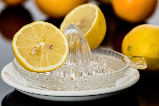 Lemon juice can help to remove the buildup and dandruff caused by hard water