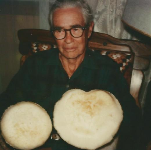 Dad Clark holding pine mushroom - edible, British Columbia.