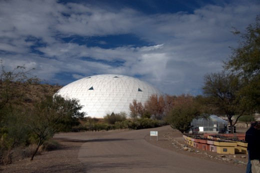 Biosphere 2 contains biomes such as a rainforest, an ocean with a coral reef, a mangrove wetlands area, a savannah grassland, a fog desert, an agricultural system, a human habitat, and below-ground infrastructure.