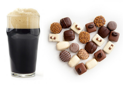 stout beer next to chocolates forming a heart