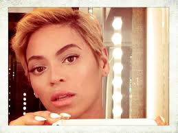 "Queen Bey with a shorter, less ""adored""  pixie crop hair-do.  It is a lace-front wig"