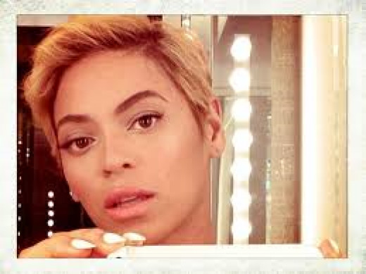 """Queen Bey with a shorter, less """"adored""""  pixie crop hair-do.  It is a lace-front wig"""