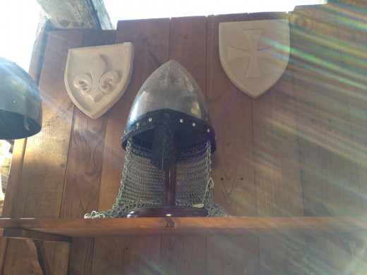 The light in this medieval shop in a castle in France shining on a hood from a Templar Knight seemed almost magical.