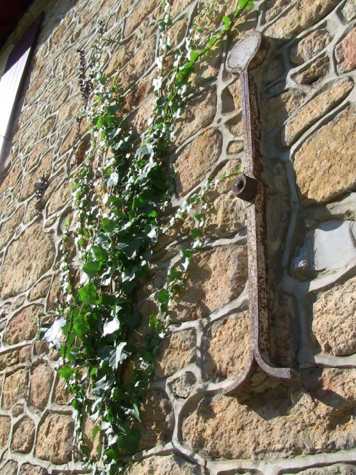 This old wall bracket in Bordeaux, France would look fine straight on, but the angle provides a shadow that gives it more interest.