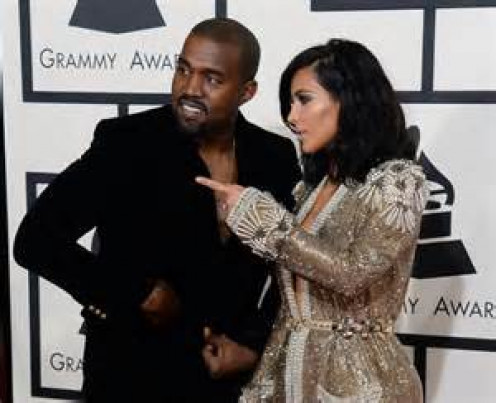 Kanye West is seen here with his wife Kim Kardashian. West stays in the tabloids and the news more for his personal life than he does for his musical gifts.