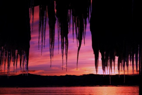 Evening sunset colors the icicle curtain