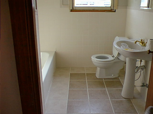 After installing a new toilet, new bathtub, and ceramic wall and floor tile.
