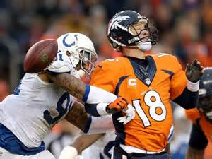 Peyton Manning taking a beating in playoff loss to the Colts.