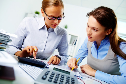 Accountants processing payments