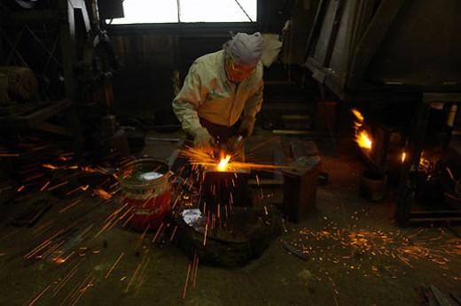 Bladesmith Toshihisa Yoshizawa hard at work