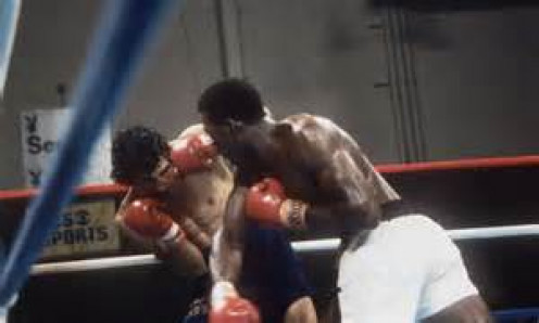 Matthew Saad Muhammad is seen here landing a right on Yaqui Lopez in their 175 pound title clash.
